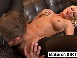 Thick boobed MILF gets dicked down on the couch