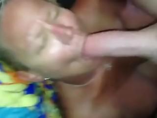 Grandma sucking a big white cock and receiving a big facial cumshot load