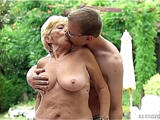 Young nerdy guy fucking light-haired granny at pool