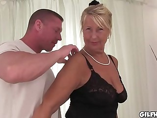 Horny granny bitchy infront of camera in hotel room