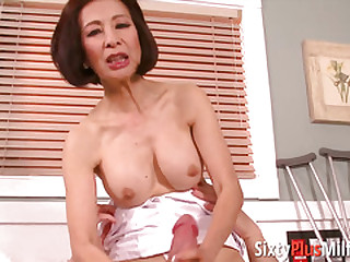 Old Asian nurse sucking and riding patient cock