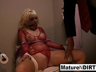 Tied up blonde babe takes his big dick in her ball-sac