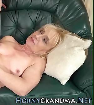 Older blonde rides cock